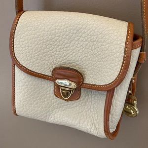 Dooney and Bourke vintage cream tan crossbody bag